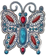A piece of art with a beautiful butterfly of stamped silver, embellished with turquoise and coral in the Southwestern Native American style, created with a high degree of realism.  This design is sure to bring compliments!