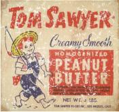 Tom Sawyer peanut butter is a vintage ad from 1945. The design has a lightly distressed look as though you've had it for years.