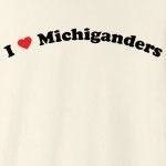 "Call it ""I love Michiganders"" or ""I heart Michiganders,"" this is how you can show your love for Michiganders. Exclusive design featuring cool curved text with a strong red heart."