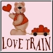 A tole art teddybear with a large red heart, pulling a wooden waggon with more hearts. The love train is coming!