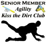 "The fun part of agility is making light of the mistakes that we make. This dog agility shirt shows a person falling to the ground, and thence invited to the ""Agility Kiss the Dirt Club"" Ptui brush off and go on."