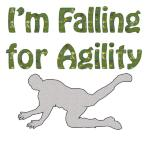"Looking for a special dog agility tee shirt, sweat shirt or tank top?  The person falling down is a unique perspective.  Above the figure is the text ""I'm Falling for Agility""  Funny?"