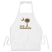 Brown South Cackalacky Palmetto Moon BBQ Apron features the South Carolina palmetto moon logo in brown.