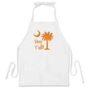 Say hello with the Orange Hey Y'all Palmetto Moon BBQ Apron. It features the South Carolina palmetto moon.