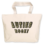 Auties Rock! in letters that look like cartoonish gray rock. One of several Autistics Rock autism pride designs. Celebrate yourself and autistic people with this autistic pride design.
