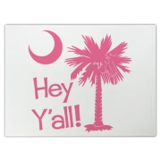 Say hello with the Pink Hey Y'all Palmetto Moon Cutting Board. It features the South Carolina palmetto moon.