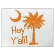Say hello with the Orange Hey Y'all Palmetto Moon Cutting Board. It features the South Carolina palmetto moon.