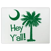 Say hello with the Green Hey Y'all Palmetto Moon Cutting Board. It features the South Carolina palmetto moon.