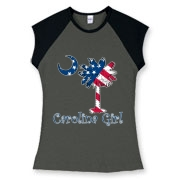 Buy a U.S. Flag Carolina Girl Women's Fitted Cap Sleeve Tee featuring the American flag in the background of the South Carolina palmetto moon logo.