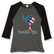Buy a U.S. Flag Carolina Girl Women's Fitted Baseball Tee featuring the American flag in the background of the South Carolina palmetto moon logo.