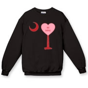 A Candy Heart Palmetto Moon Crewneck Sweatshirt with Be Mine! Perfect for Valentine's Day, it features a pink candy heart on the South Carolina Palmetto Moon with Be Mine.