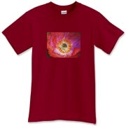 The richly luminous reds and purples of this poppy stand out on this shirt. A flower to wear with joy!