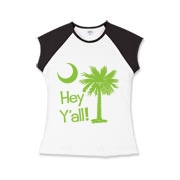 Say hello with the Lime Green Hey Y'all Palmetto Moon Girls Cap Sleeve T-Shirt. It features the South Carolina palmetto moon.