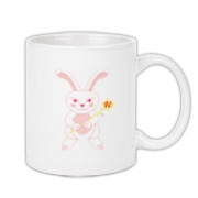 Celebrate Chinese New Year with this cute year of the metal rabbit mug! This rabbit is happily carrying a red and gold pinwheel with bells! Also a great gift for someone who just loves rabbits!  Pink version. Image on both sides.