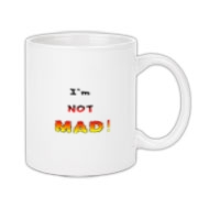 This clever anger coffee mug says: I'm NOT MAD! The growing anger is apparent in the fonts and colors used for emphasis.