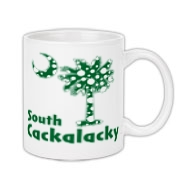 Green Polka Dots South Cackalacky Palmetto Moon Coffee Mug features a Polka Dot South Carolina palmetto moon logo in green.
