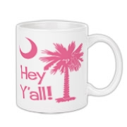 Say hello with the Pink Hey Y'all Palmetto Moon Coffee Mug. It features the South Carolina palmetto moon.