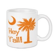 Say hello with the Orange Hey Y'all Palmetto Moon Coffee Mug. It features the South Carolina palmetto moon.