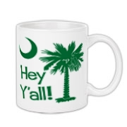 Say hello with the Green Hey Y'all Palmetto Moon Coffee Mug. It features the South Carolina palmetto moon.