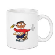Cute school clothes and back to school gifts for boys featuring cartoon stick figure of a young boy sitting at a school desk holding up a pencil and a piece of paper. Fun school apparel and back to school gear for boys.