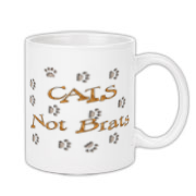 Cat prints walk across your shirt with the words Cats Not Brats. Nice design to let people know you've chosen to hear the pitter patter of soft, furry feet and share your life with a loving, sweet furbaby.