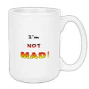 This satirical anger large coffee mug says: I'm NOT MAD! The words grow bigger (louder) and hotter in a crescendo.