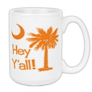 Say hello with the Orange Hey Y'all Palmetto Moon Large Coffee Mug. It features the South Carolina palmetto moon.