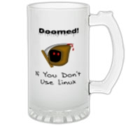 This clever Linux frosted glass stein says: Doomed If You Don't Use Linux. For emphasis it has an ominous image of the grim reaper.