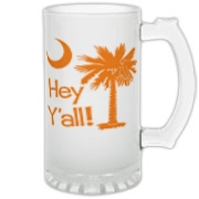 Say hello with the Orange Hey Y'all Palmetto Moon Frosted Glass Stein. It features the South Carolina palmetto moon.