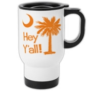 Say hello with the Orange Hey Y'all Palmetto Moon Travel Mug. It features the South Carolina palmetto moon.