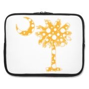 Buy a Yellow Polka Dot Palmetto Moon Laptop Sleeve that features a yellow palmetto moon with white polka dots.