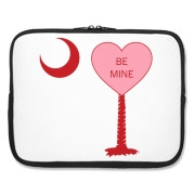A Candy Heart Palmetto Moon Laptop Sleeve with Be Mine! Perfect for Valentine's Day, it features a pink candy heart on the South Carolina Palmetto Moon with Be Mine.