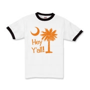 Say hello with the Orange Hey Y'all Palmetto Moon Kids Ringer T-Shirt. It features the South Carolina palmetto moon.