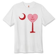 A Candy Heart Palmetto Moon Hanes Cool Dri T-shirt with Be Mine! Perfect for Valentine's Day, it features a pink candy heart on the South Carolina Palmetto Moon with Be Mine.